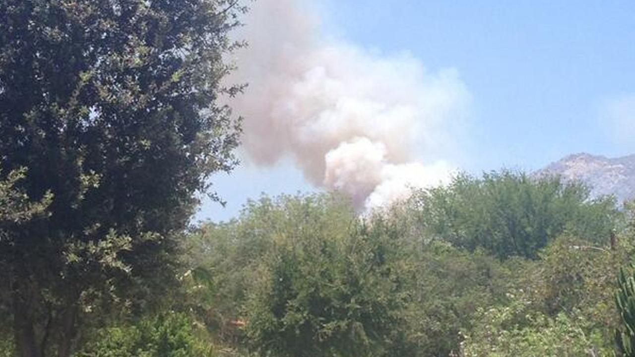 Smoke from a fire in the Glendale area is seen Sunday, June 22, 2014.