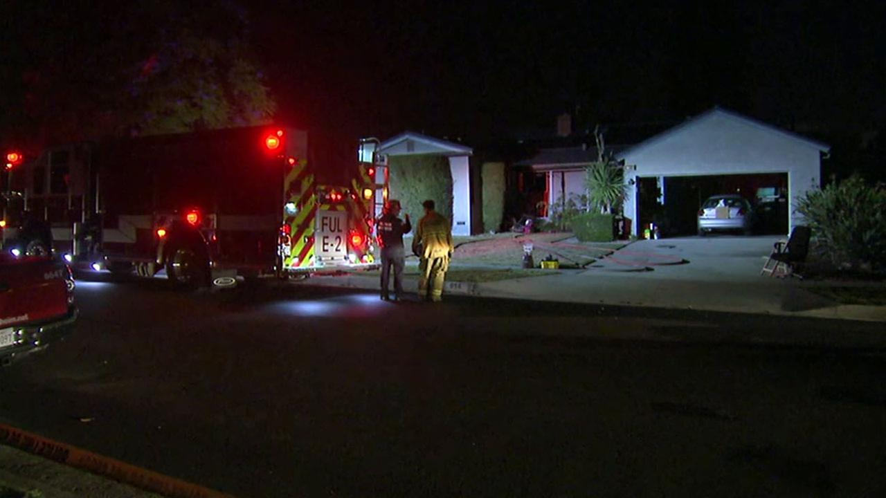 Firefighters investigated the scene of a house fire in Fullerton where a mans body was found inside on Friday, May 6, 2015.