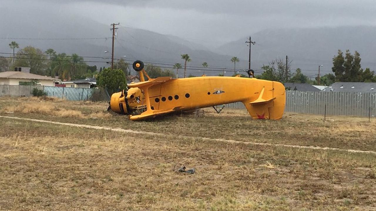 A vintage bi-plane crashed near Lankershim Avenue and 9th Street in Highland Friday, May 6, 2016.