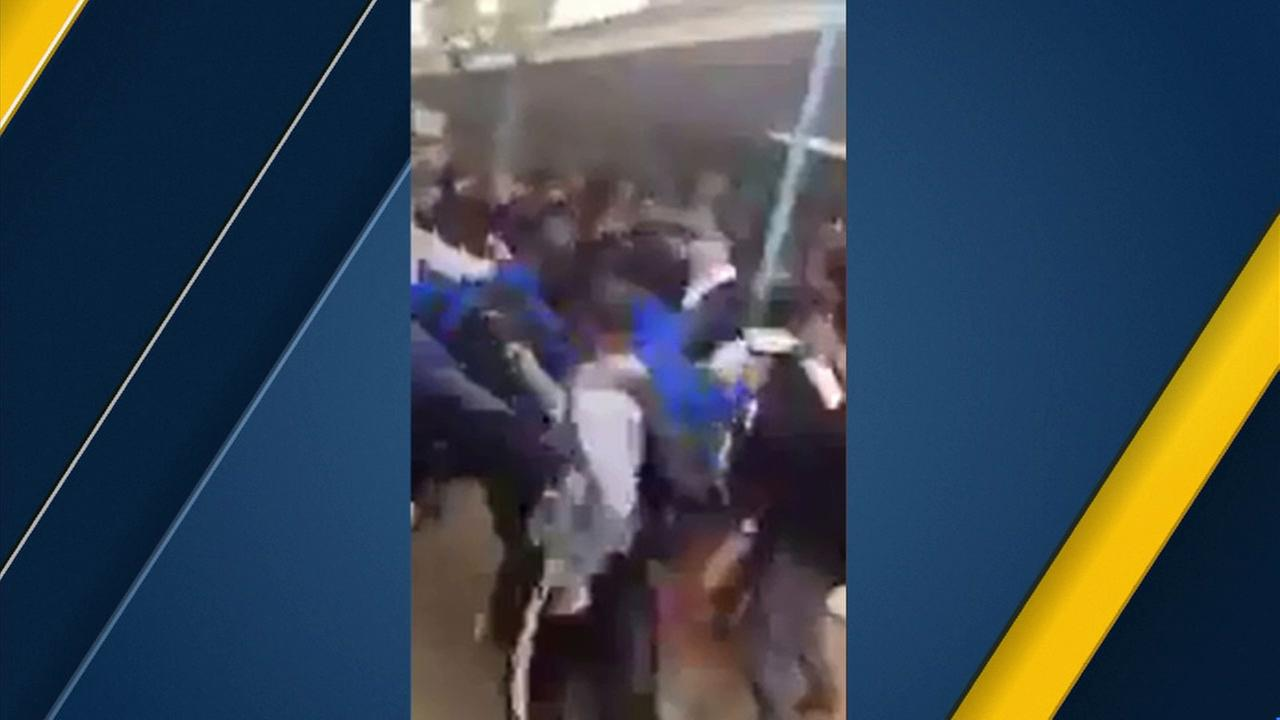 Dozens of students are caught on video in a lunchtime fight at Sylmar High School.