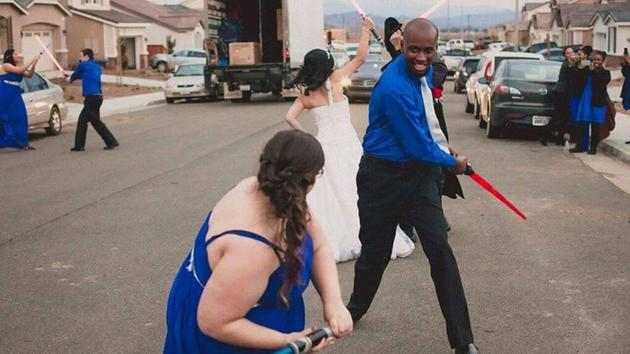 Jedi and Sith Lords battle in a lightsaber fight at Krystel and Earle Doudera's 'Star Wars' themed wedding in Temecula, California.