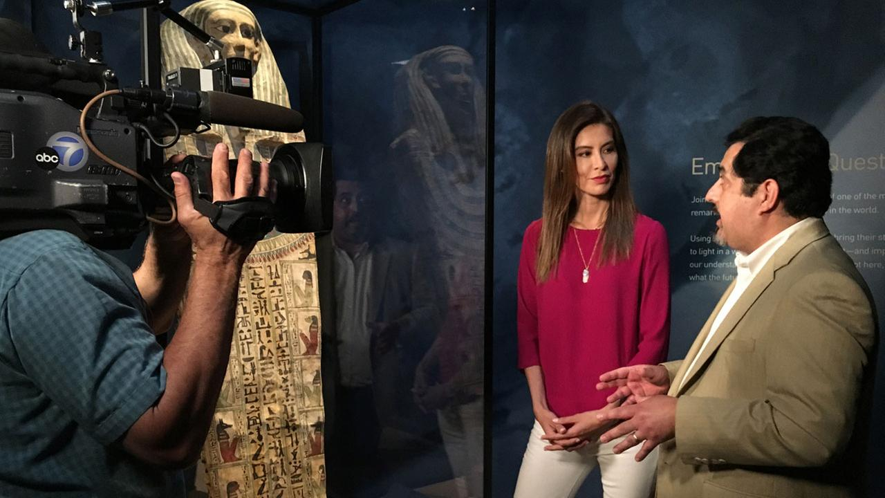 Patricia Lopez looks at the Mummies of the World exhibit at the Bowers Museum in Santa Ana for Vista L.A.