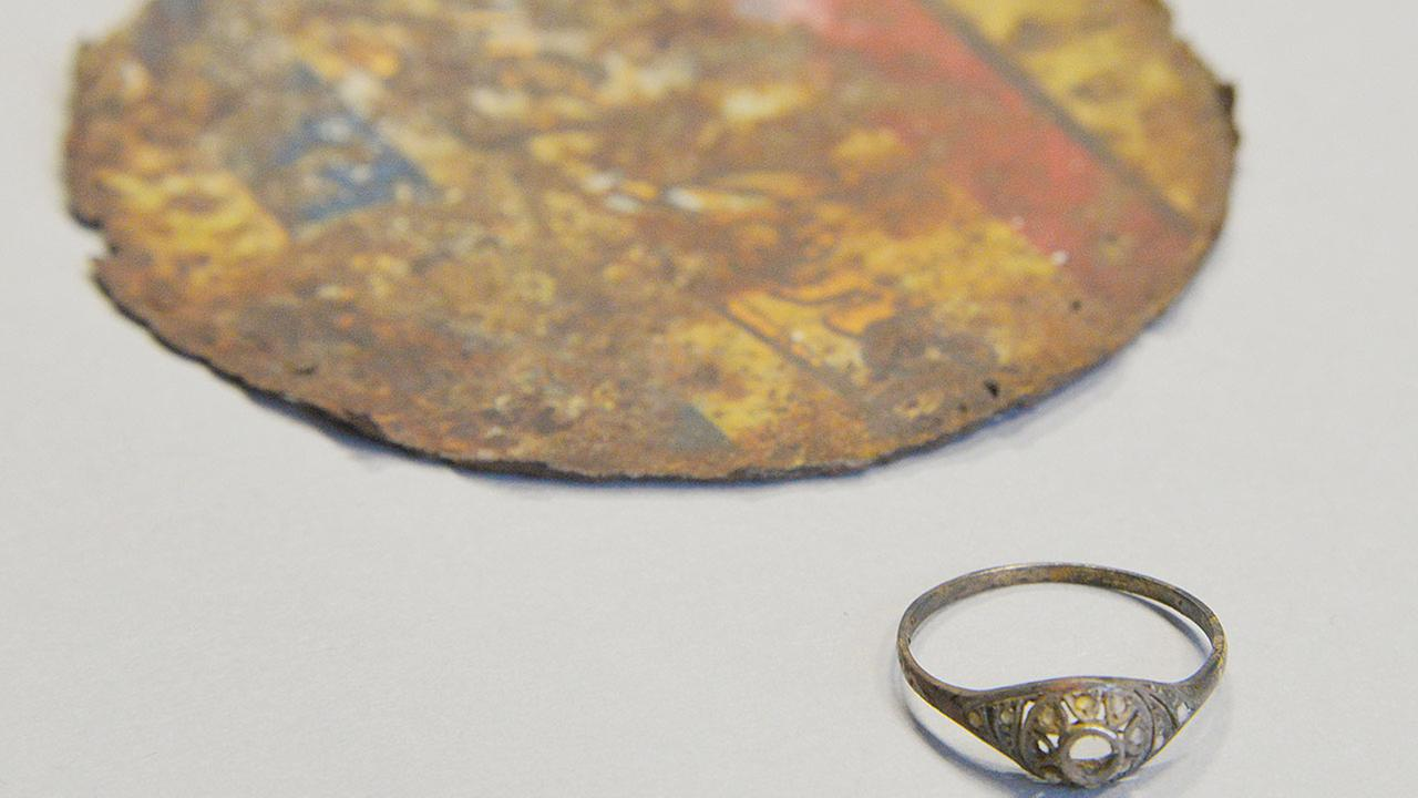 A Polish-made golden ring was found at Polands Auschwitz Museum hidden under the false base of an enameled mug that must have belonged to a victim of the Nazis death camp.