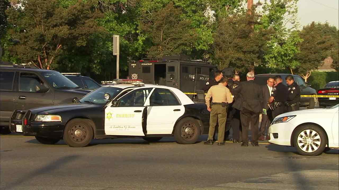 West Covina police and Los Angeles County sheriffs officials investigate an officer-involved shooting in West Covina, Calif., on Saturday, May 21, 2016.