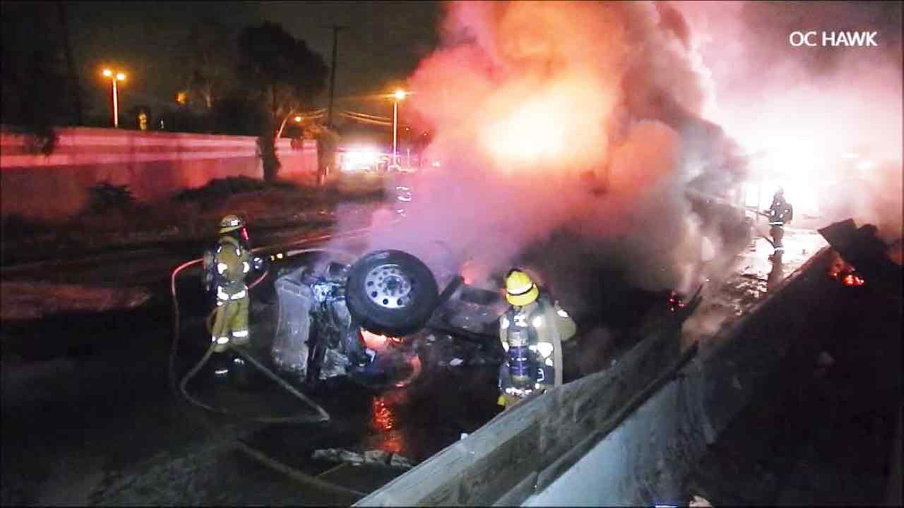 Firefighters douse flames from a big rig fiery crash in Norwalk on Saturday, May 21, 2016.