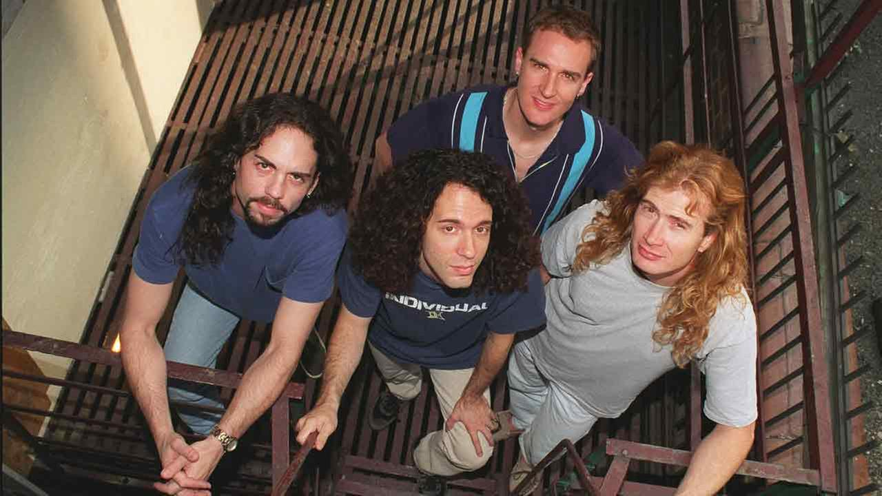 Members of the band Megadeth pose in New York Aug. 14, 1997.