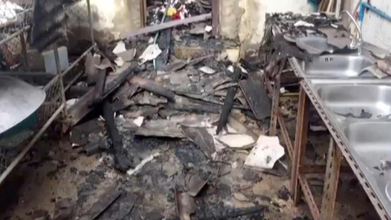 In this image, the inside of a damaged school dorm is seen where police say 18 girls, 5 to 12 years old, died in a fire in Chiang Rai province in Thailand, May 23, 2016.
