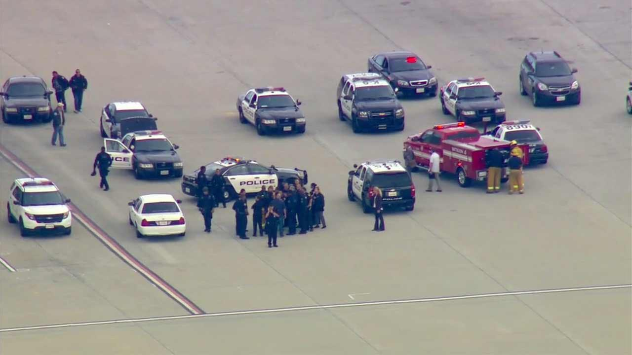 Law enforcement officials and other emergency personnel are shown at Los Angeles International Airport following a possible threat on Tuesday, May 24, 2016.