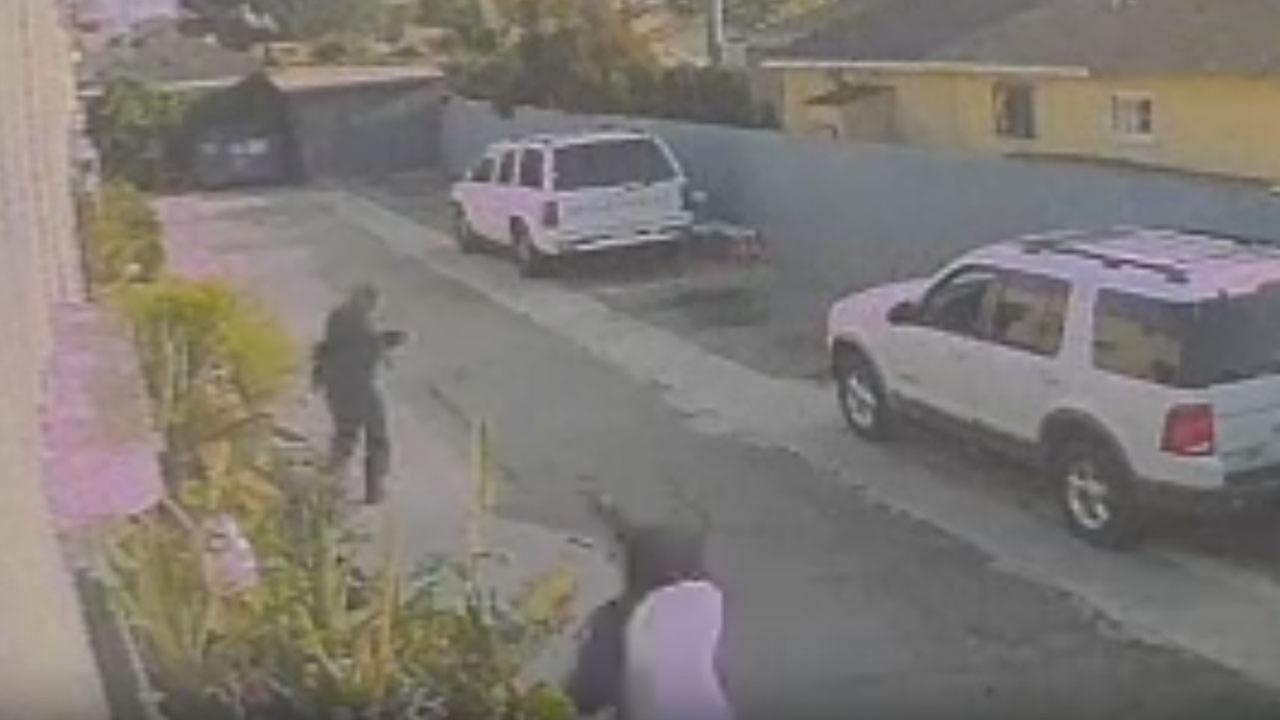 Surveillance footage captured the armed robbery of a gardener in South Los Angeles.
