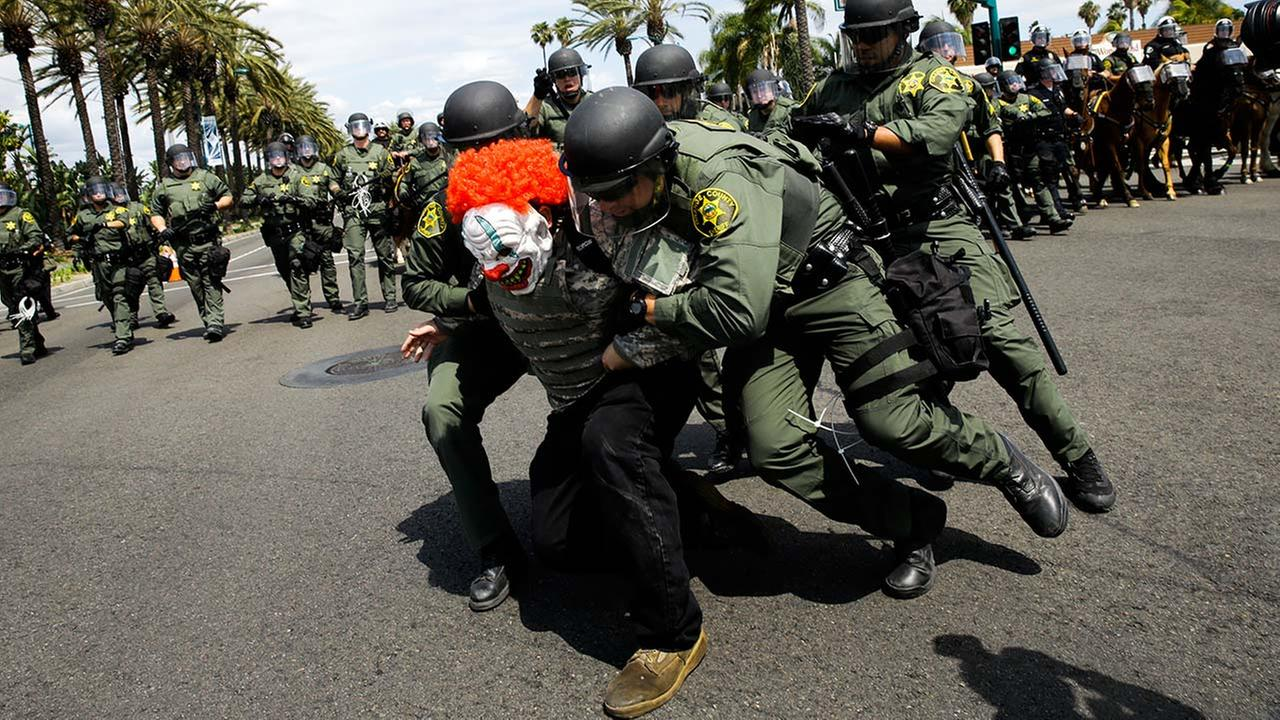 Deputies take a protester into custody outside the Anaheim Convention Center where Republican presidential candidate Donald Trump held a rally on Wednesday, May 25, 2016.
