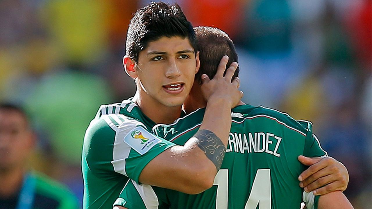 In a June 29, 2014 file photo, Mexicos Alan Pulido consoles teammate Javier Hernandez after the Netherlands defeated Mexico 2-1 during the World Cup.