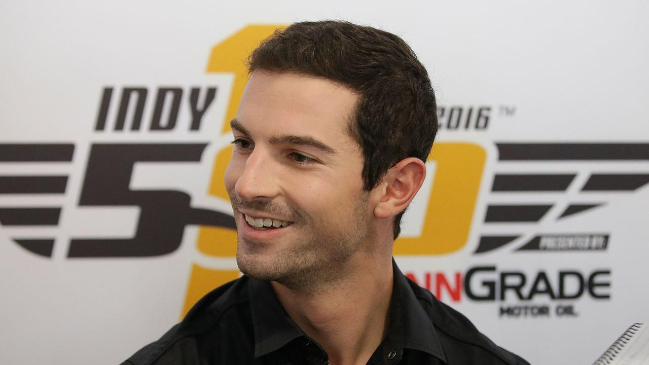 Alexander Rossi listens to a question during a news conference for the Indianapolis 500 auto race at Indianapolis Motor Speedway in Indianapolis, Thursday, May 26, 2016.