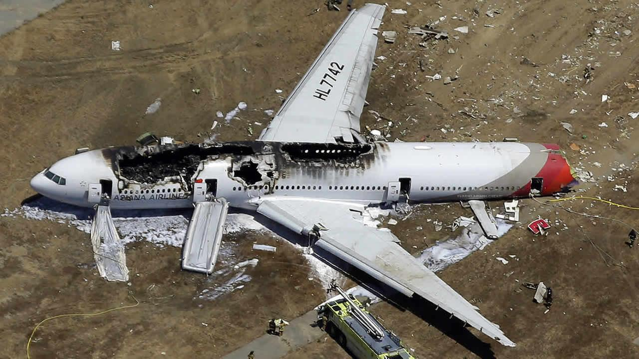In this July 6, 2013 aerial photo, the wreckage of Asiana Flight 214 lies on the ground after it crashed at the San Francisco International Airport.