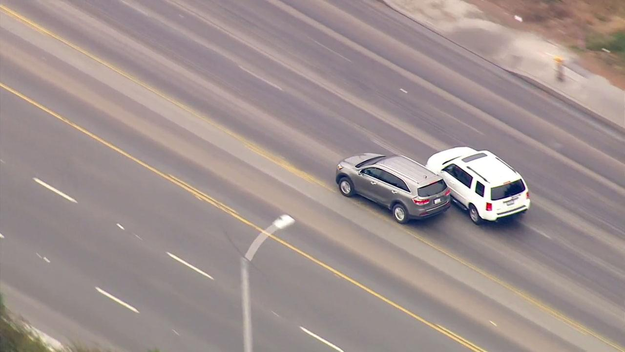 A stolen-car suspect sideswiped a vehicle as officers followed him from the South Gate area.
