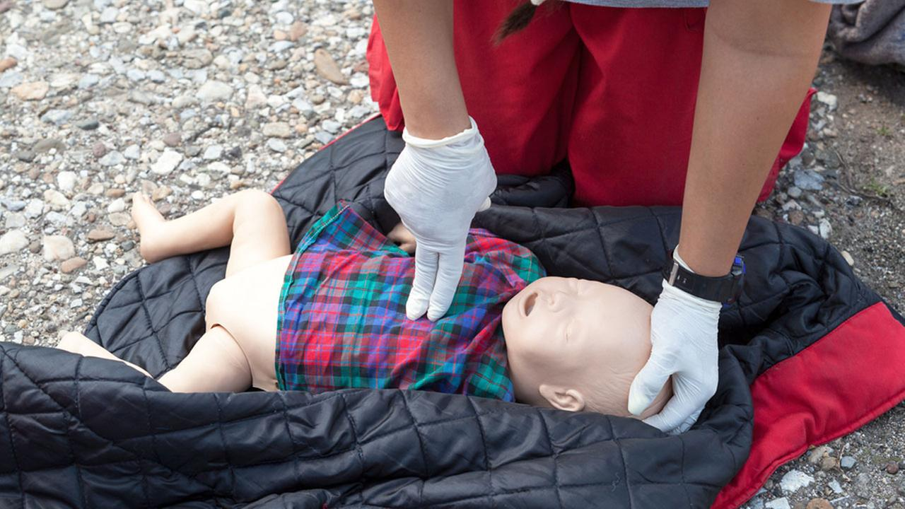 A person administers CPR on an infant doll in an undated file image.