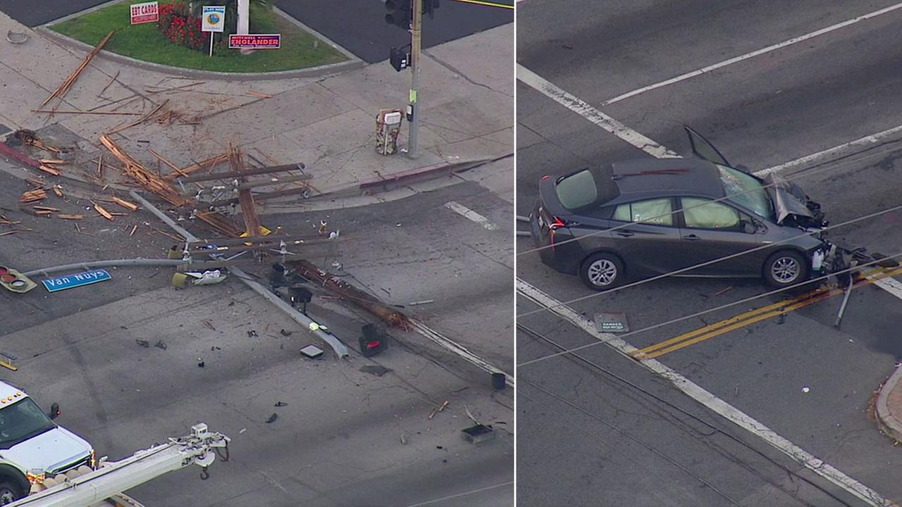 A mangled car and a shattered power pole are left along an intersection in Van Nuys. The crash caused a power outage on Friday, June 3, 2016.