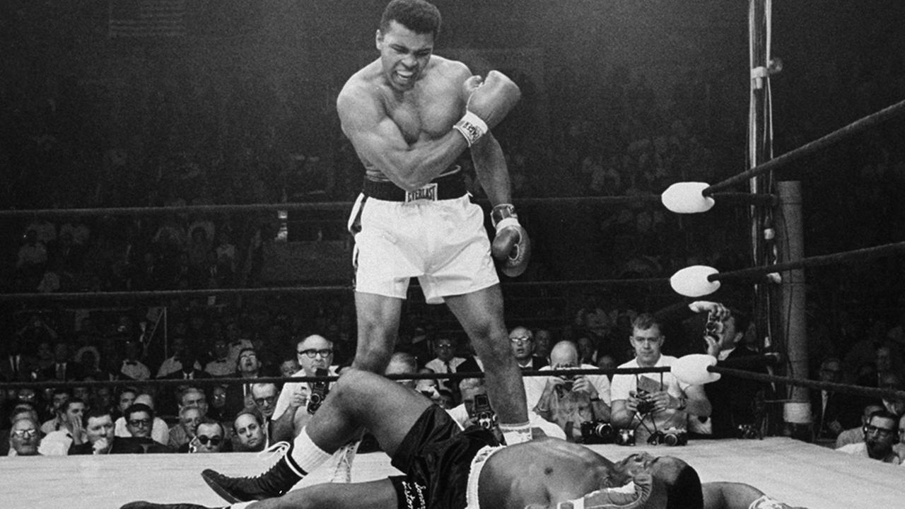 Muhammad Ali stands over fallen challenger Sonny Liston, shouting and gesturing shortly after dropping Liston with a punch on May 25, 1965, in Lewiston, Maine.John Rooney