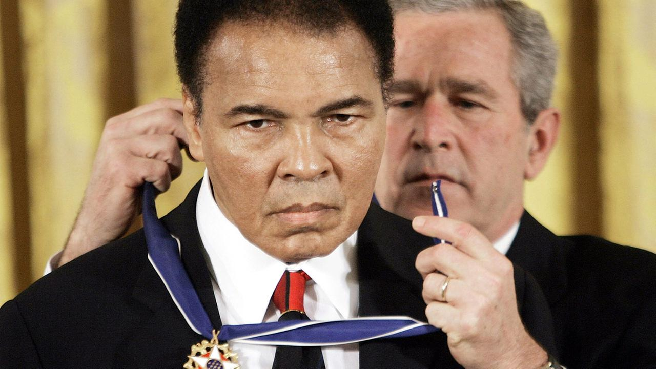 President Bush presents the Presidential Medal of Freedom to boxer Muhammad Ali in the East Room of the White House on Nov. 9, 2005.Evan Vucci