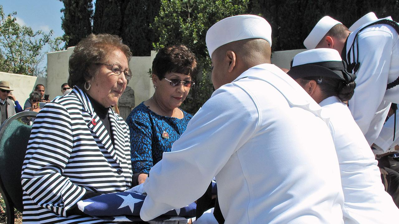 Helen Chavez, the widow of Cesar Chavez receives a flag from the U.S. Navy, honoring her husbands military service during a ceremony in Keene, Calif., Thursday, April 23, 2015.