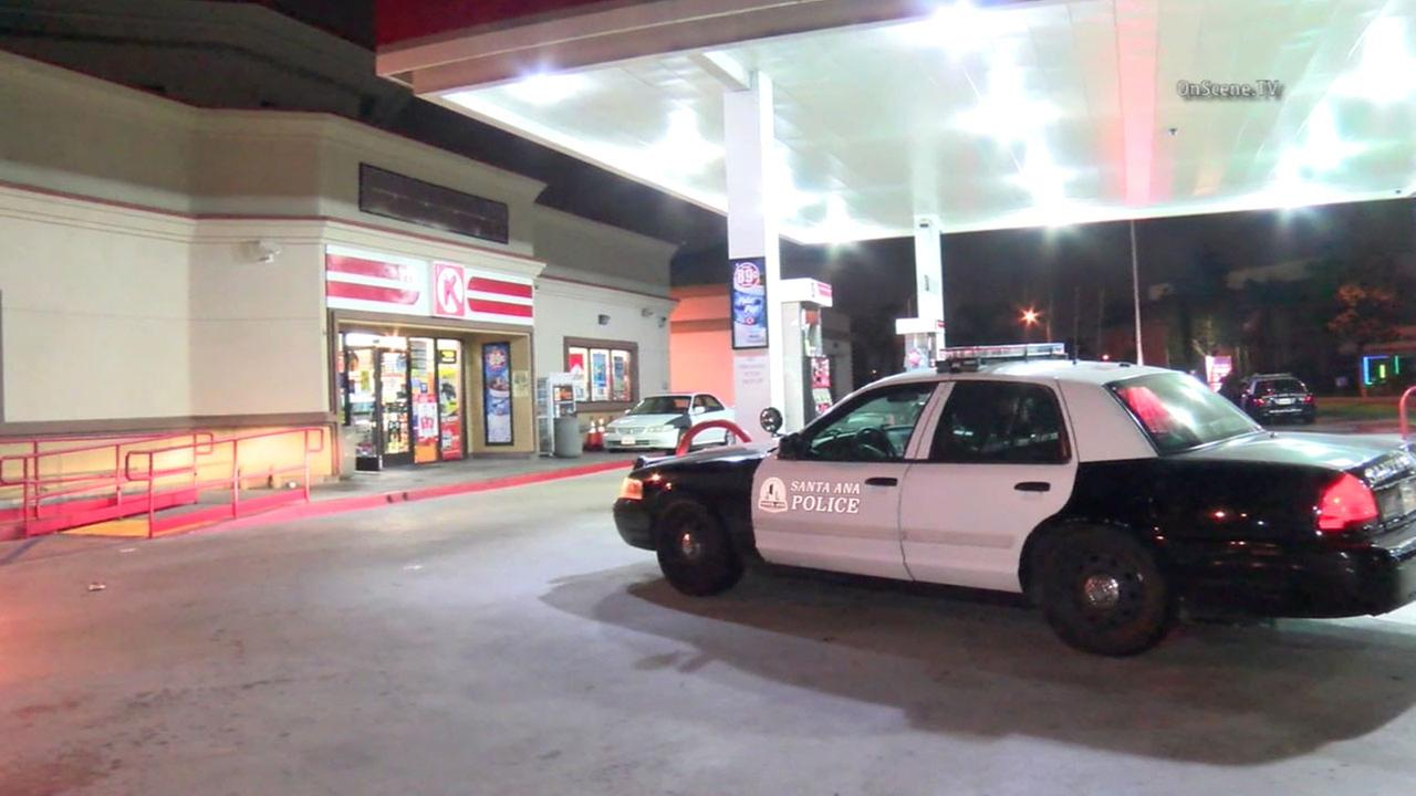 Authorities respond to reports of a woman found shot at a Santa Ana gas station on Friday, June 10, 2016.