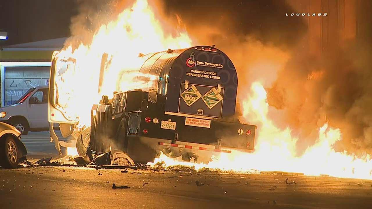 A tanker truck is seen engulfed in flames following a crash near downtown Los Angeles on Monday, June 20, 2016.