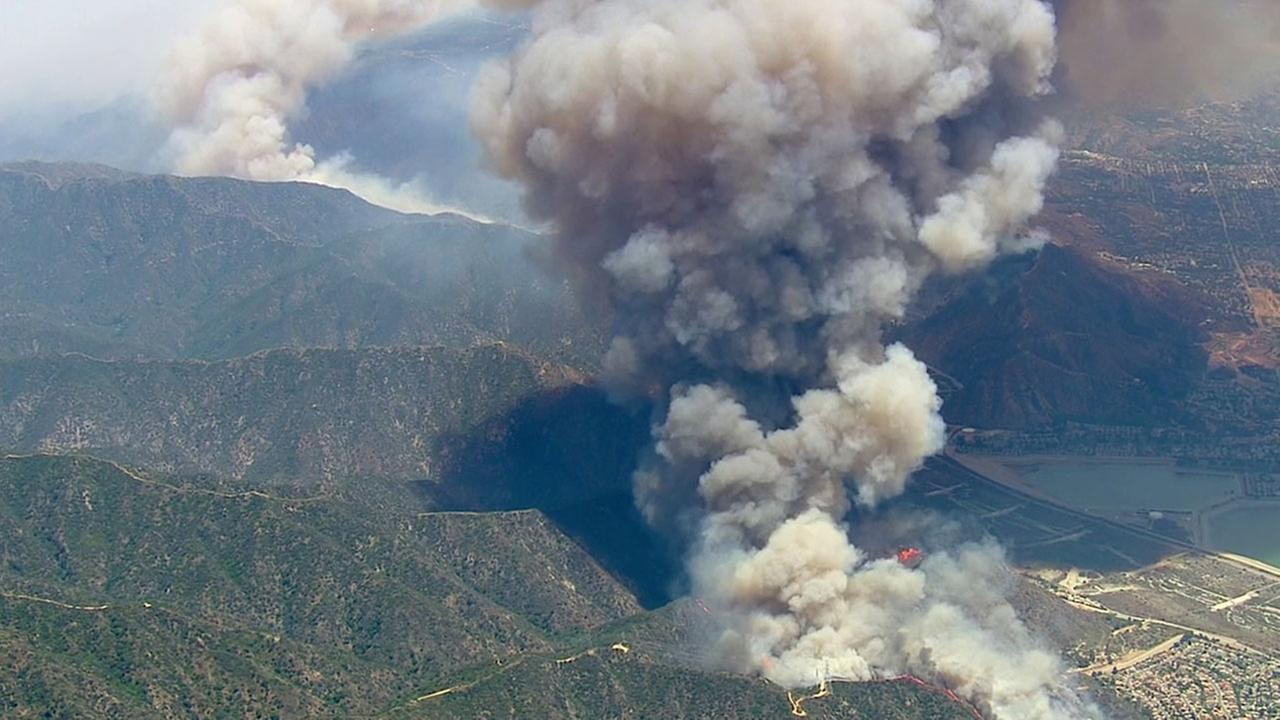 A fast-spreading fire, dubbed the Fish Fire, burns above Duarte in the Angeles National Forest on Monday, June 20, 2016.KABC