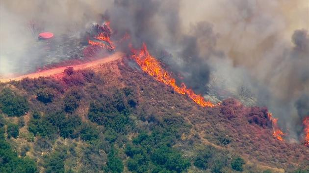 <div class='meta'><div class='origin-logo' data-origin='KABC'></div><span class='caption-text' data-credit=''>AIR7 HD captured the smoke and flames from a brush fire above Duarte, dubbed the Fish Fire, in the Angeles National Forest on Monday, June 20, 2016.</span></div>