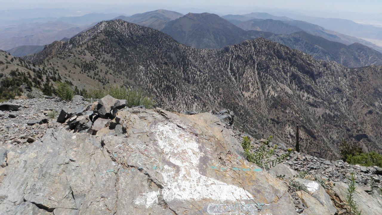 A faded painting sits atop Telescope Peak at Death Valley National Park. A San Diego woman pleaded guilty to painting it, and the National Park Service plans to remove it.