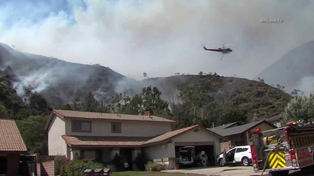 Fire crews drop water onto the San Gabriel Complex Fire behind a community in the Duarte/Azusa area on Friday, June 24, 2016.