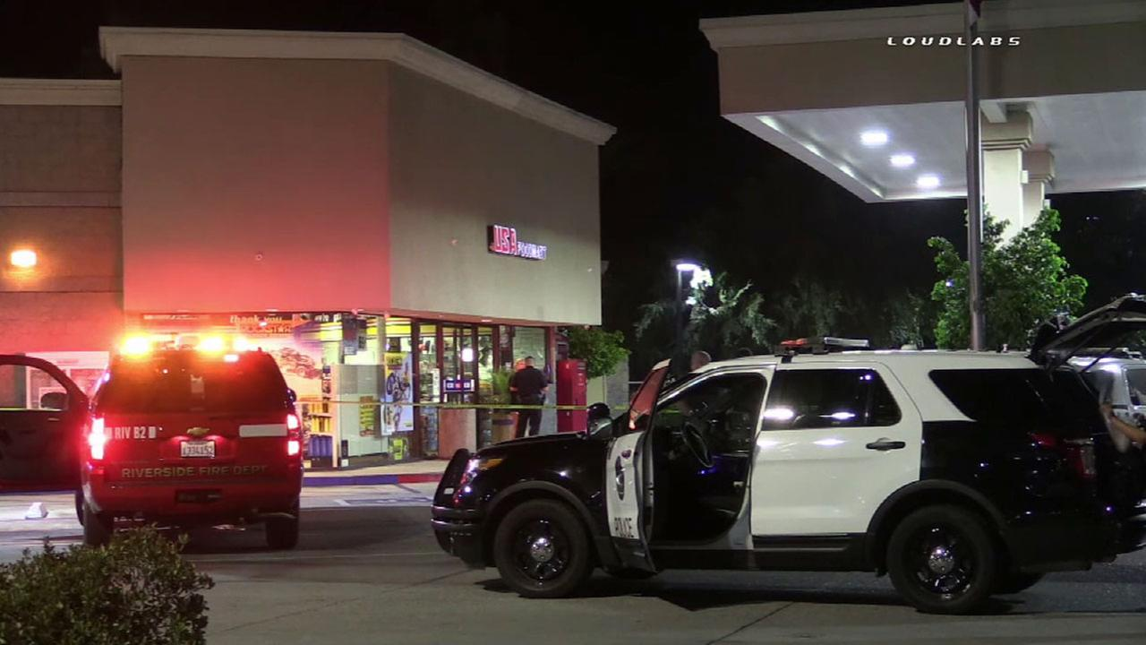 Authorities cordoned off a USA Gas station in Riverside after three people were shot on Saturday, June 25, 2016.