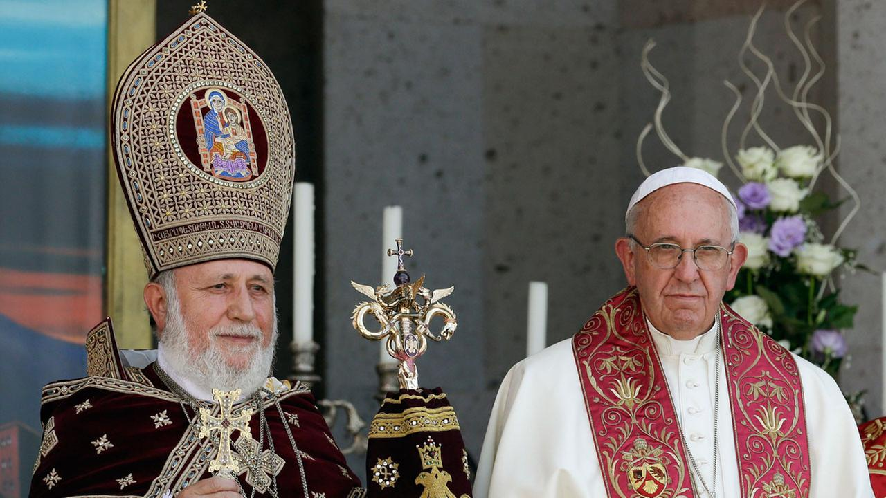 Pope Francis, right, participates in the Divine Liturgy celebrated by Catholicos Karekin II, left, at the Armenian Apostolic Cathedral in Armenia, Sunday, June 26, 2016.