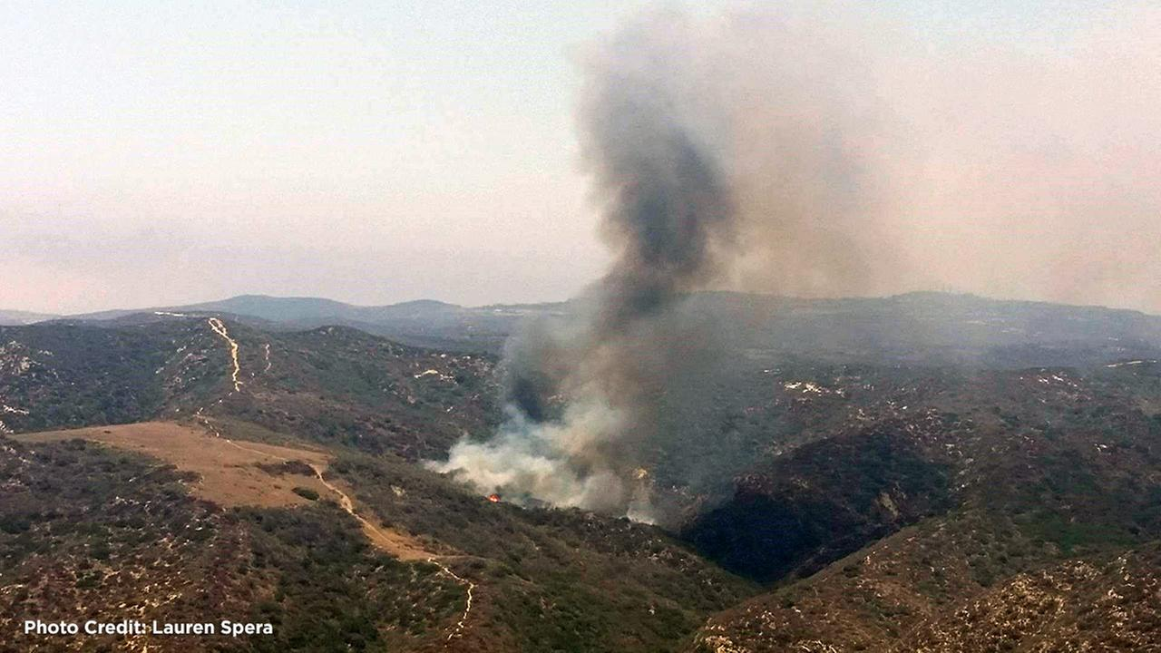 A brush fire in Laguna Beach forced fire officials to close two parks on Sunday, June 26, 2016.