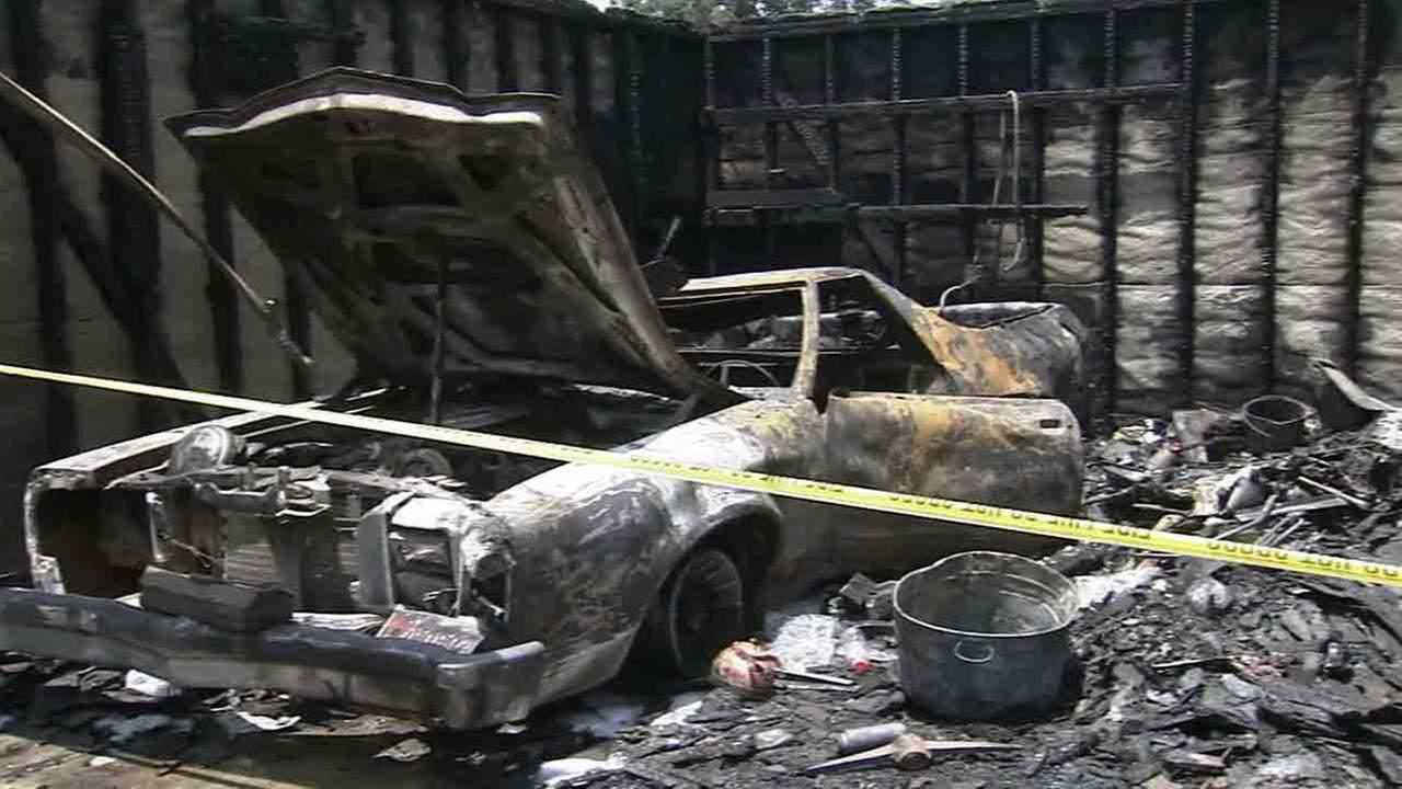 Two Good Samaritans pulled their 94-year-old neighbor from a burning garage in Mission Hills Wednesday, June 25, 2014.