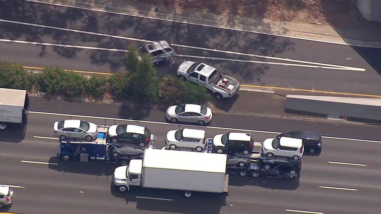 Suspects in an allegedly stolen vehicle smashed into a white SUV as they tried to exit the 5 Freeway near Griffith Park.