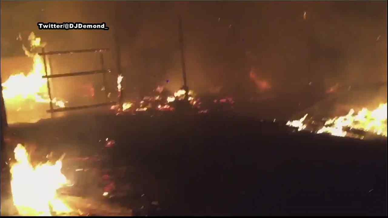 A massive blaze tears through a shed in Quartz Hill, Calif., on Thursday, June 30, 2016.