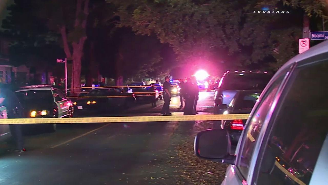 Authorities blocked off a section of East 57th Street in South Los Angeles after four people were shot in the early hours of Tuesday, July 5, 2016.