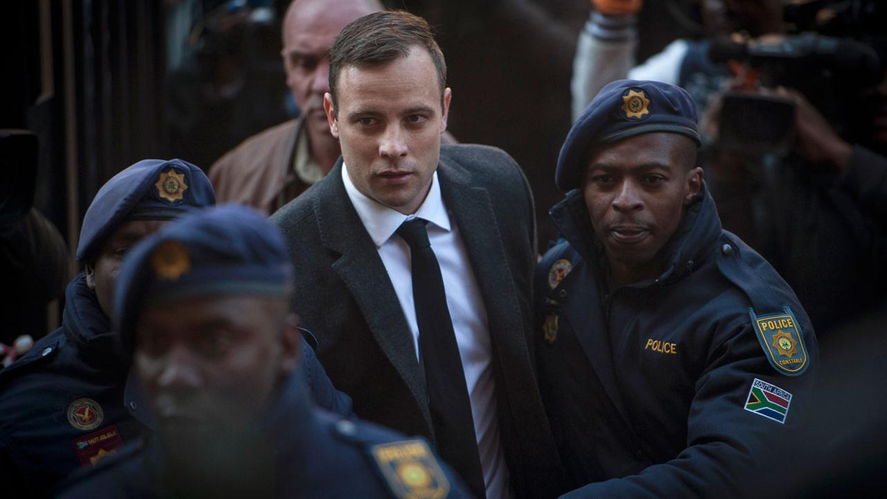 Oscar Pistorius, center, arrives at the High Court in Pretoria, South Africa Wednesday, July 6, 2016.