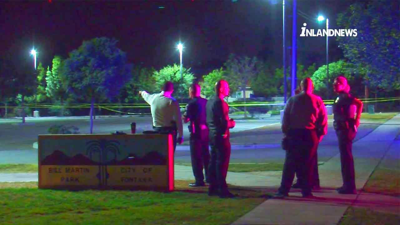 Law enforcement officials investigate the scene of a fatal shooting at Bill Martin Park in Fontana on Tuesday, July 5, 2016.