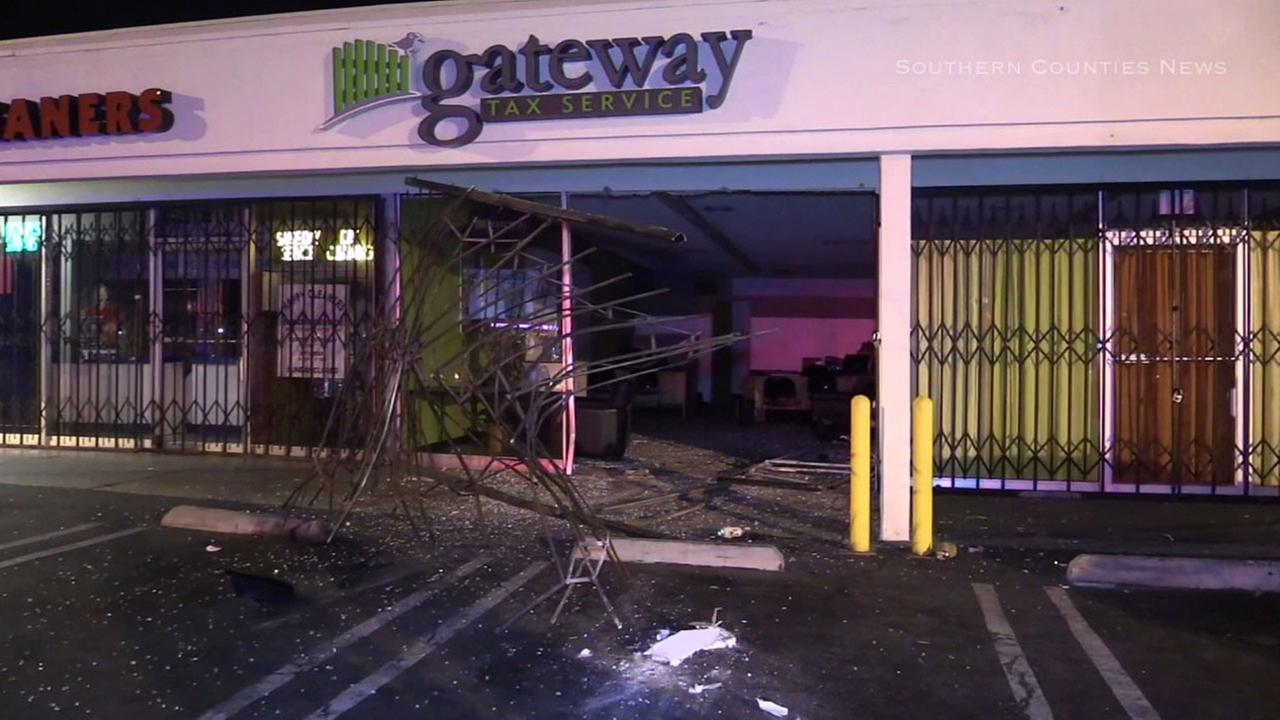 A car smashed through the front end of a business at a strip mall in Long Beach on Tuesday, July 12, 2016.