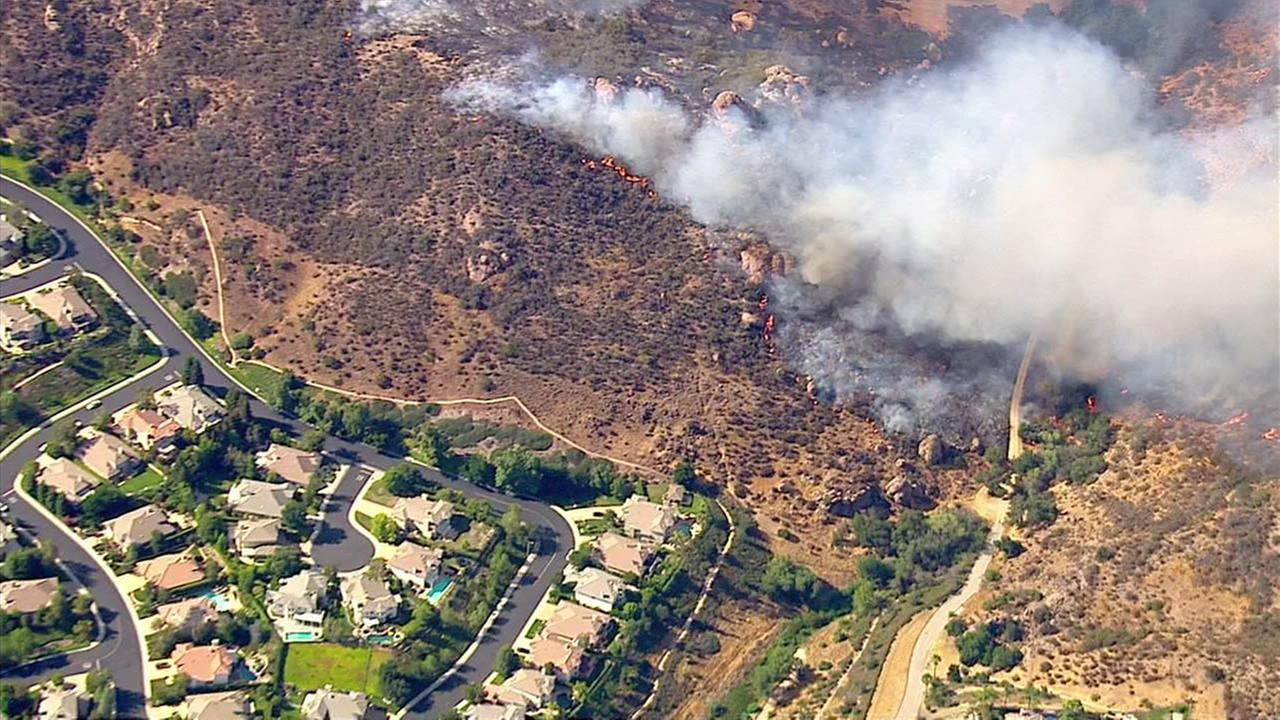 Crews battled a brush fire in the Lake Sherwood area on Wednesday, July 13, 2016.