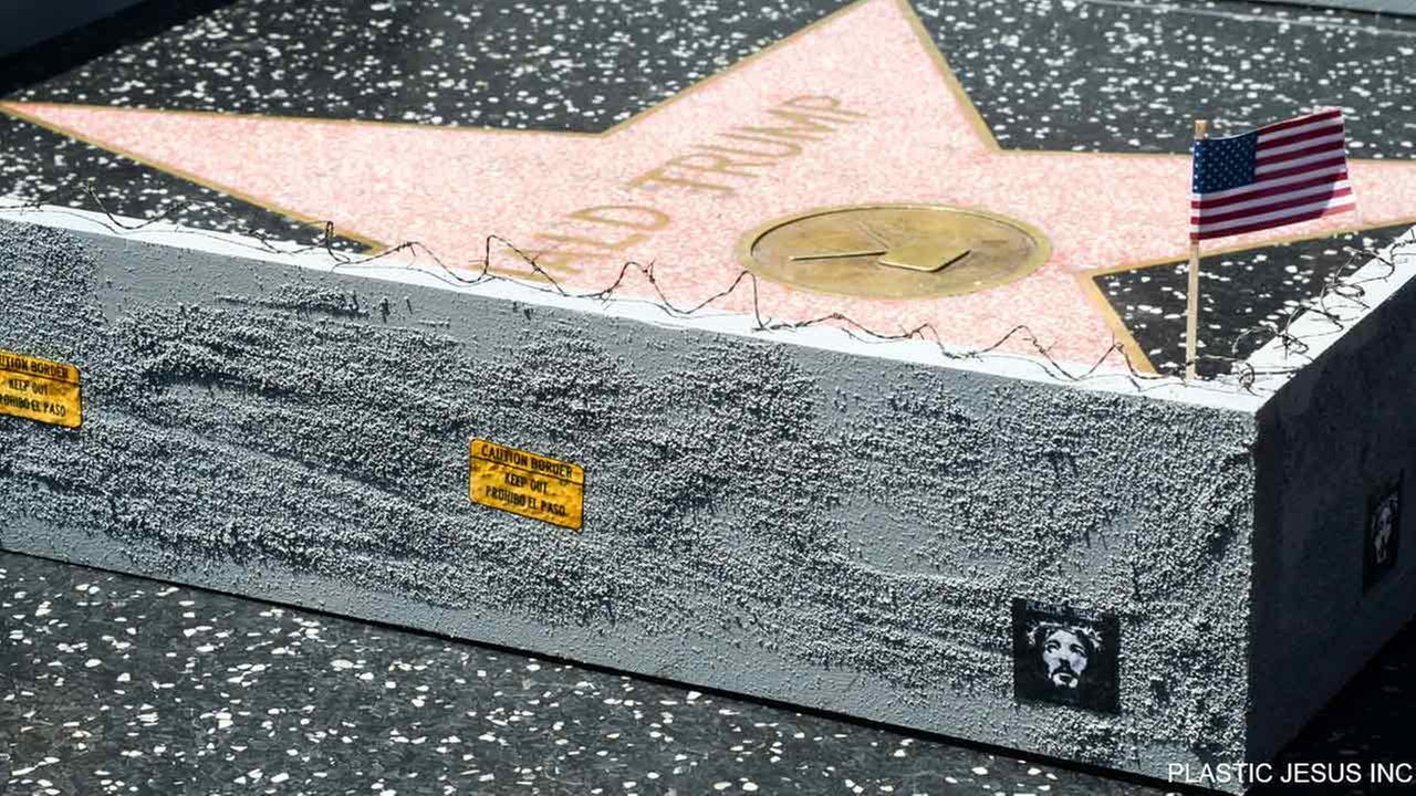 A street artist known as Plastic Jesus constructed a miniature wall around Donald Trumps star on the Hollywood Walk of Fame.