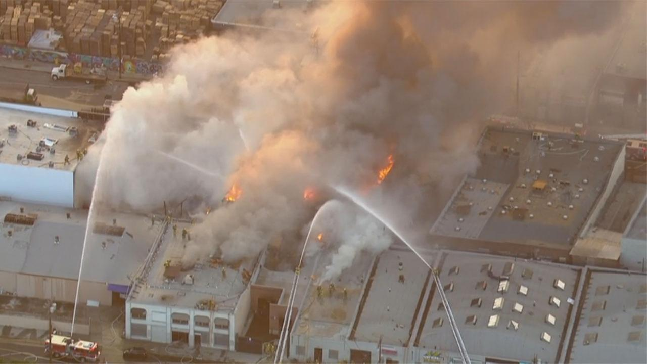 Firefighters battle a blaze at a large commercial complex in downtown Los Angeles.