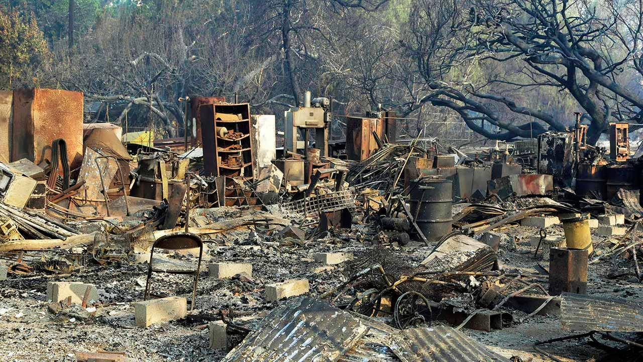 Burned-out film sets and oak trees at Sable Ranch, which has Old West-style buildings used for movie locations in Santa Clarita, Calif., are seen Monday morning, July 25, 2016.Nick Ut