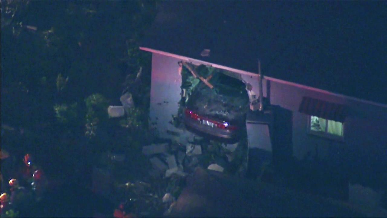 A car crashed into a home in the 14800 block of South Orchard Avenue in Gardena on Wednesday, July 27, 2016.