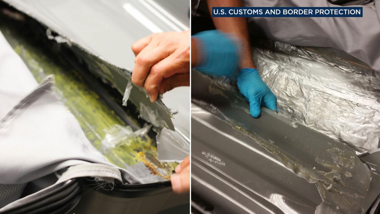 U.S. Customs and Border Protection officers handle crystal meth hidden in a womans luggage at Los Angeles International Airport on July 18, 2016.