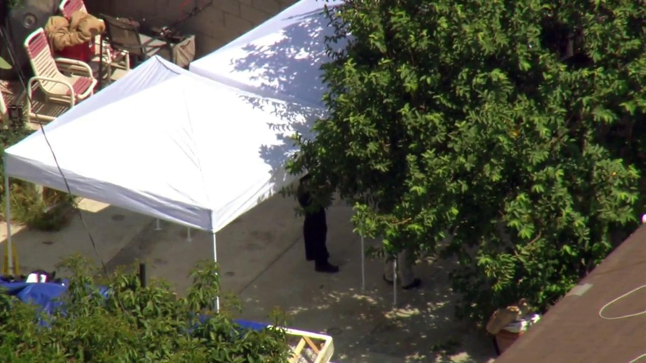 An investigation was underway for possible human remains that may be buried in the backyard of a Santa Ana home.