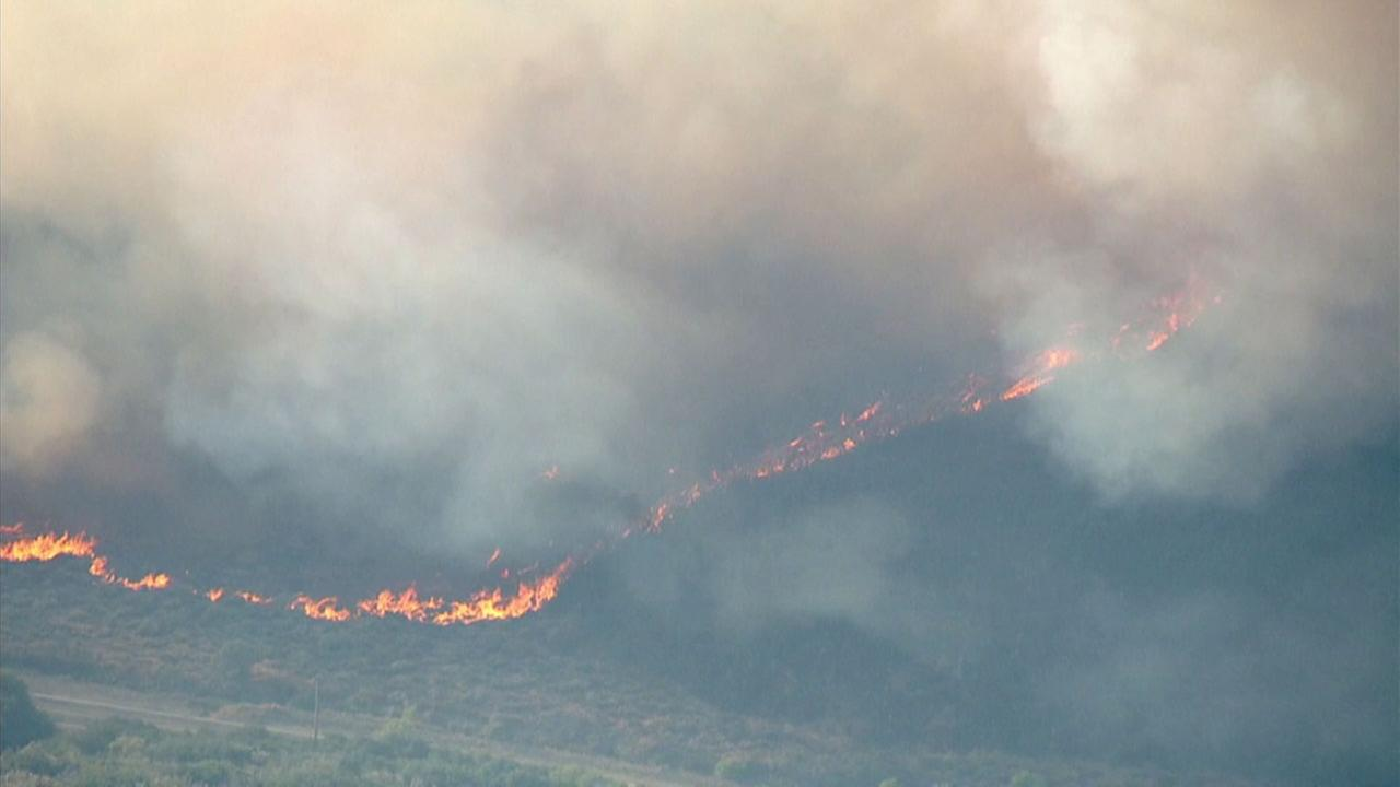 A brush fire erupted and quickly spread to 10 acres just east of Spunky Canyon in northern Los Angeles County.