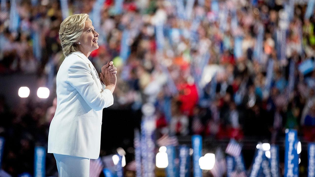 Democratic presidential candidate Hillary Clinton stands on stage after speaking during the Democratic National Convention in Philadelphia, Thursday, July 28, 2016.