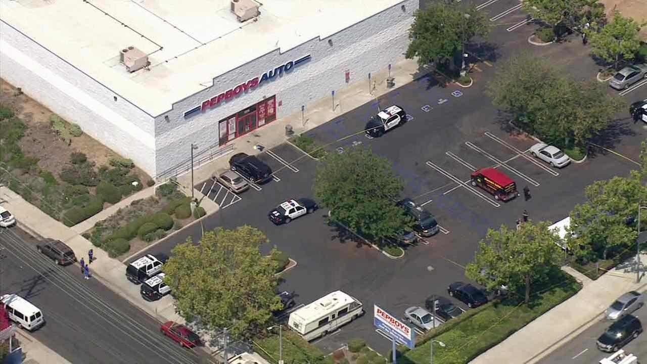 Officers respond to the scene of a deadly shooting outside a Pep Boys store in Harbor City on Friday, July 29, 2016.