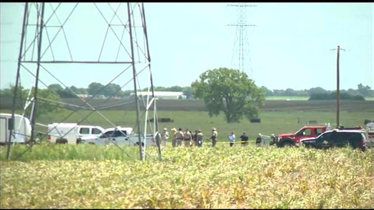 Local and federal officials investigate the scene of a fatal hot air balloon crash in Lockhart, Texas, on Saturday, July 30, 2016.